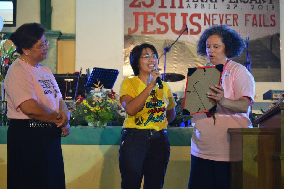 Teresa Skinner reading proclamation, with Evelyn Arcangel as translator. Pastora Lisa listens.